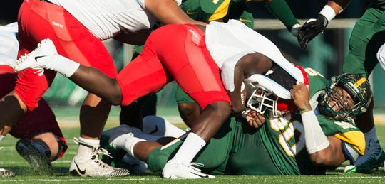 Norfolk State's Walter Brantley pulls down Delaware State's Mike Waters for the tackle during an NCAA college football game Saturday, Sept. 29, 2018, in Norfolk, Va.