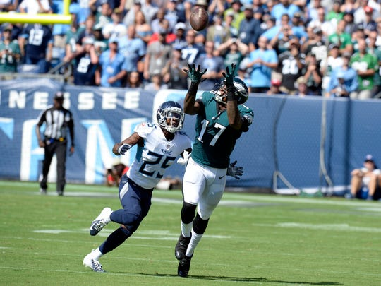 Philadelphia Eagles wide receiver Alshon Jeffery (17) makes a catch as he is defined by Tennessee Titans cornerback Adoree' Jackson (25) in the first half of an NFL football game Sunday, Sept. 30, 2018, in Nashville, Tenn. (AP Photo/Mark Zaleski)