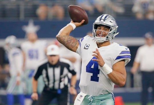 Dallas Cowboys quarterback Dak Prescott (4) throws in the first half of an NFL football game against the Detroit Lions in Arlington, Texas, Sunday, Sept. 30, 2018. (AP Photo/Roger Steinman)