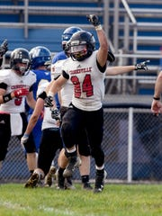 Carson Rupe celebrates a fumble recovery for Crooksville against Vincent Warren last season.