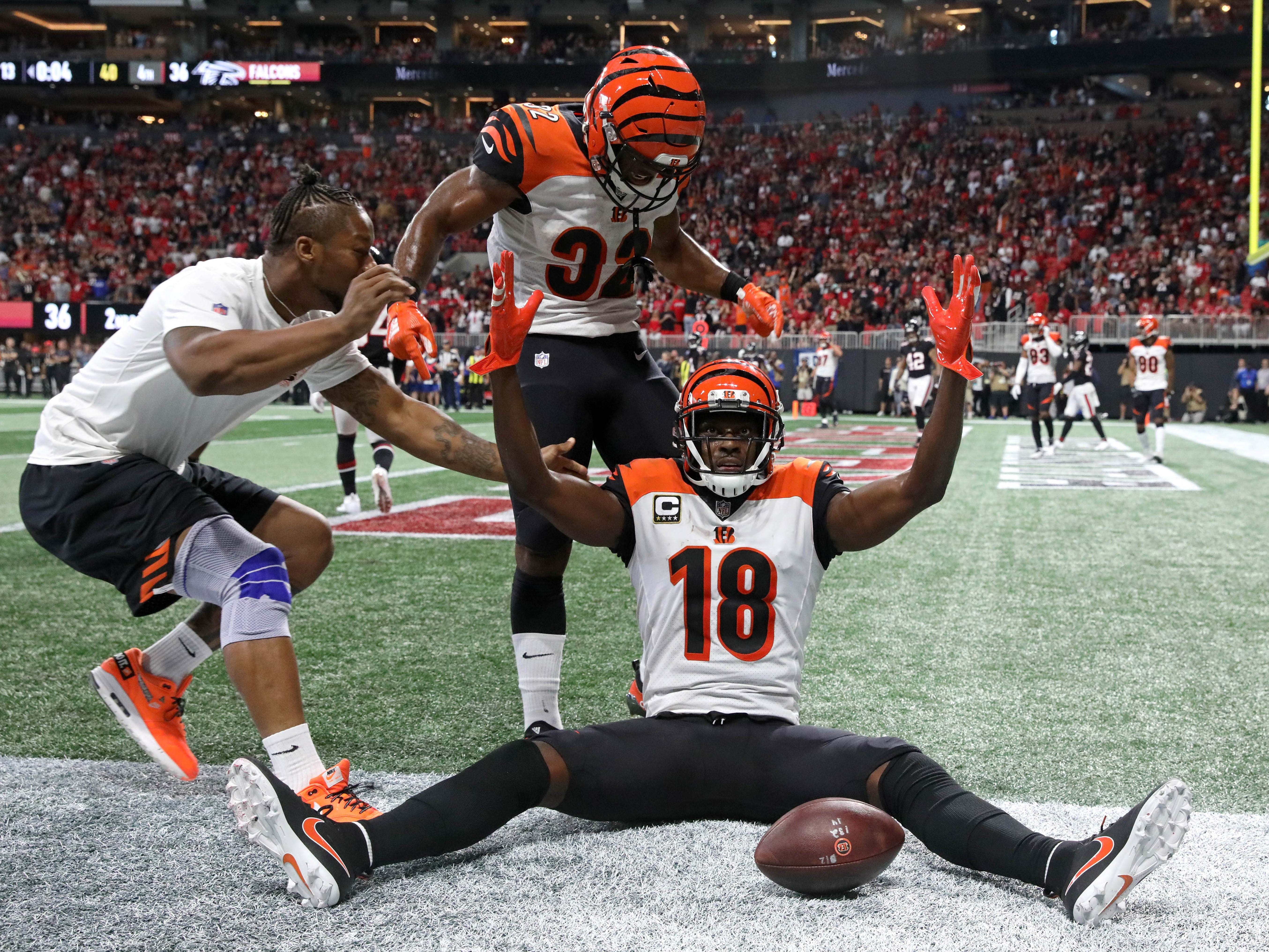 Cincinnati Bengals wide receiver A.J. Green celebrates  after making the  game-winning touchdown catch in the fourth quarter against the Atlanta Falcons at Mercedes-Benz Stadium.