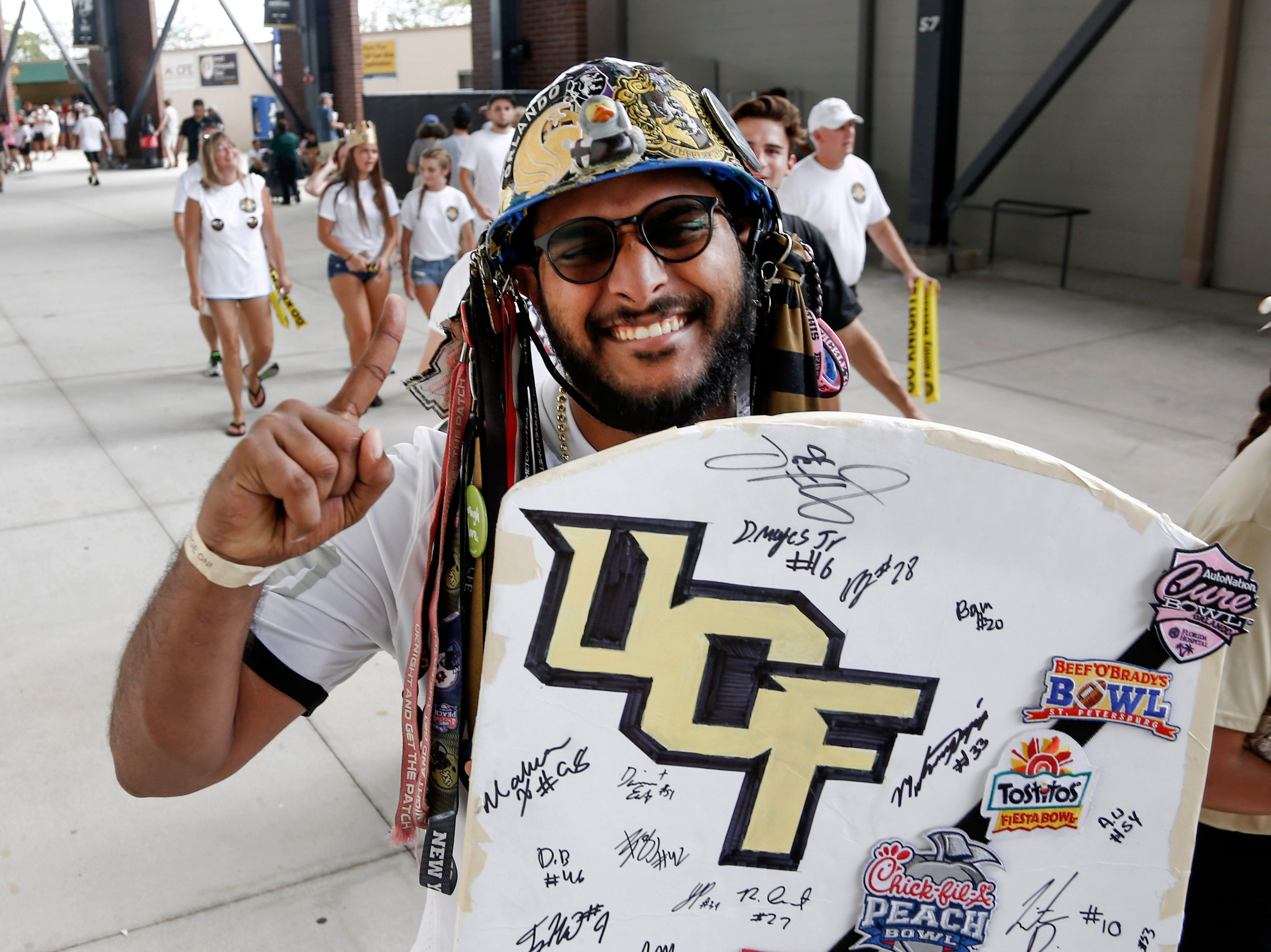 UCF fan Arjun Govindean walks under the stands before a game between the UCF Knights and the Pittsburgh Panthers at Spectrum Stadium.