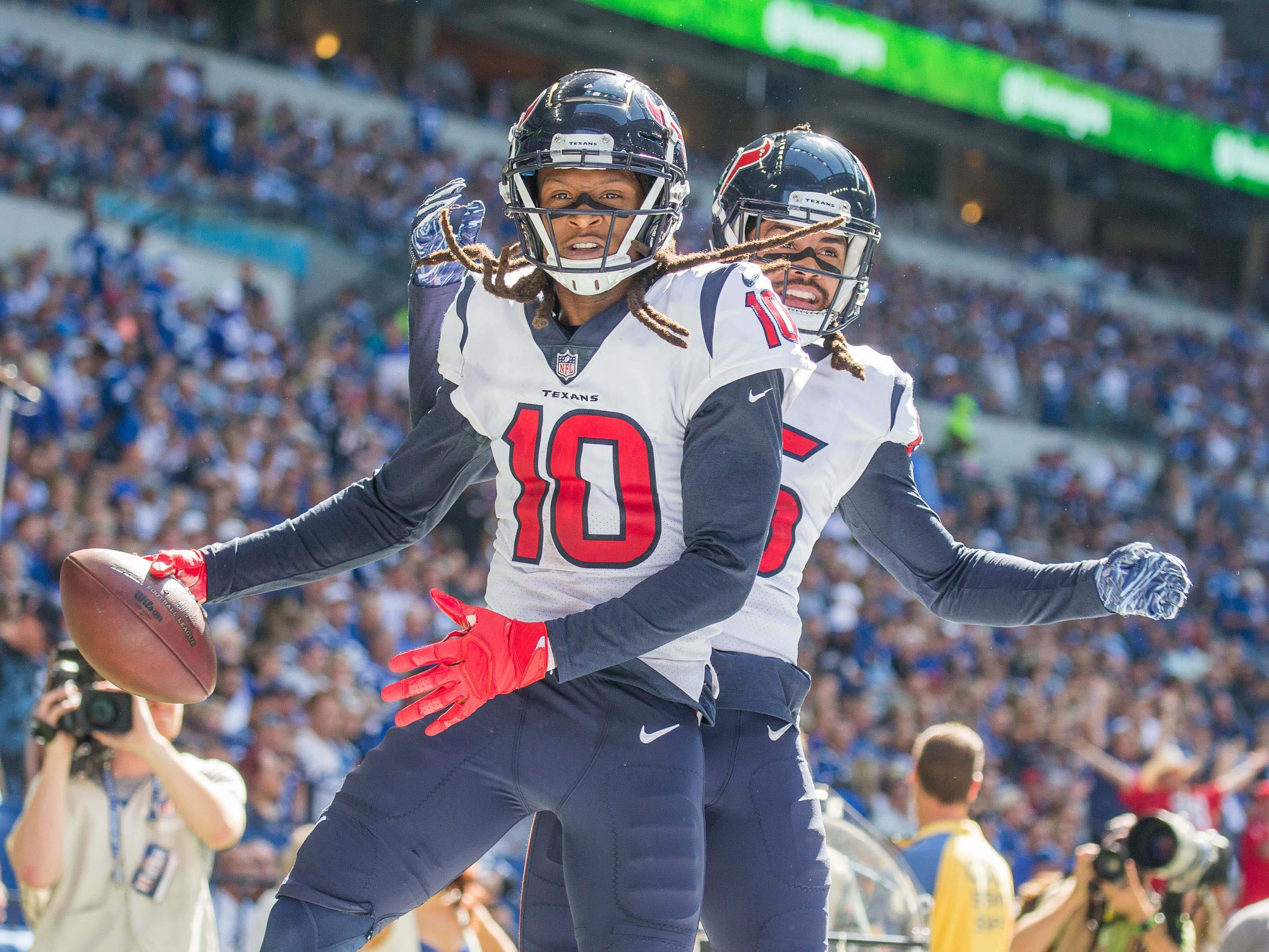 Texans wide receiver DeAndre Hopkins (10) celebrates his touchdown with wide receiver Will Fuller (15).