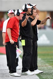 Louisville Cardinals head coach Bobby Petrino yells out instructions during second half against Florida State.
