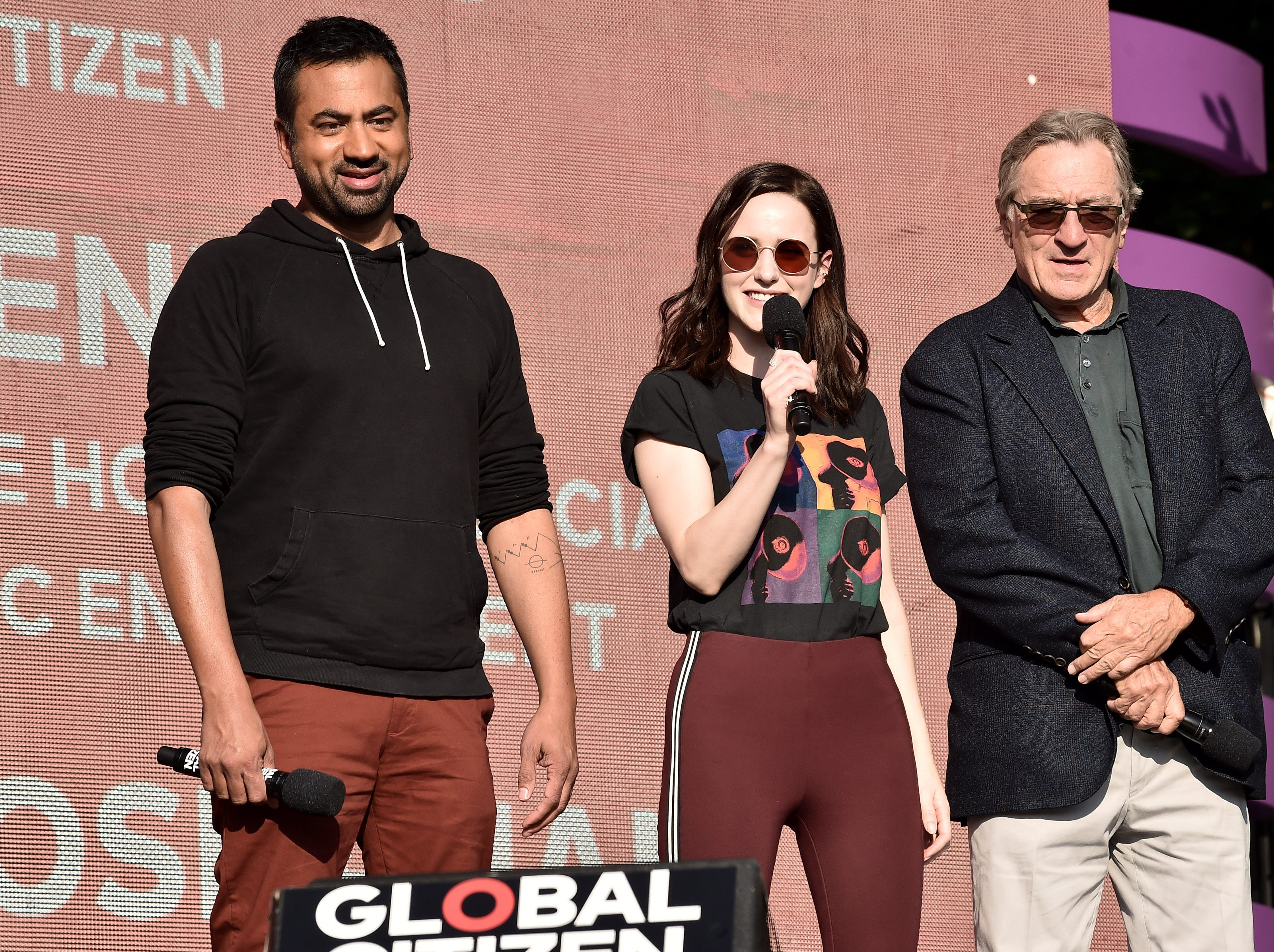 NEW YORK, NY - SEPTEMBER 29:  Former Associate Director White House Office of Public Liaison Kal Penn, actress Rachel Brosnahan and actor Robert De Niro speak onstage during the 2018 Global Citizen Concert at Central Park, Great Lawn on September 29, 2018 in New York City.  (Photo by Steven Ferdman/WireImage) ORG XMIT: 775224758 ORIG FILE ID: 1043278594