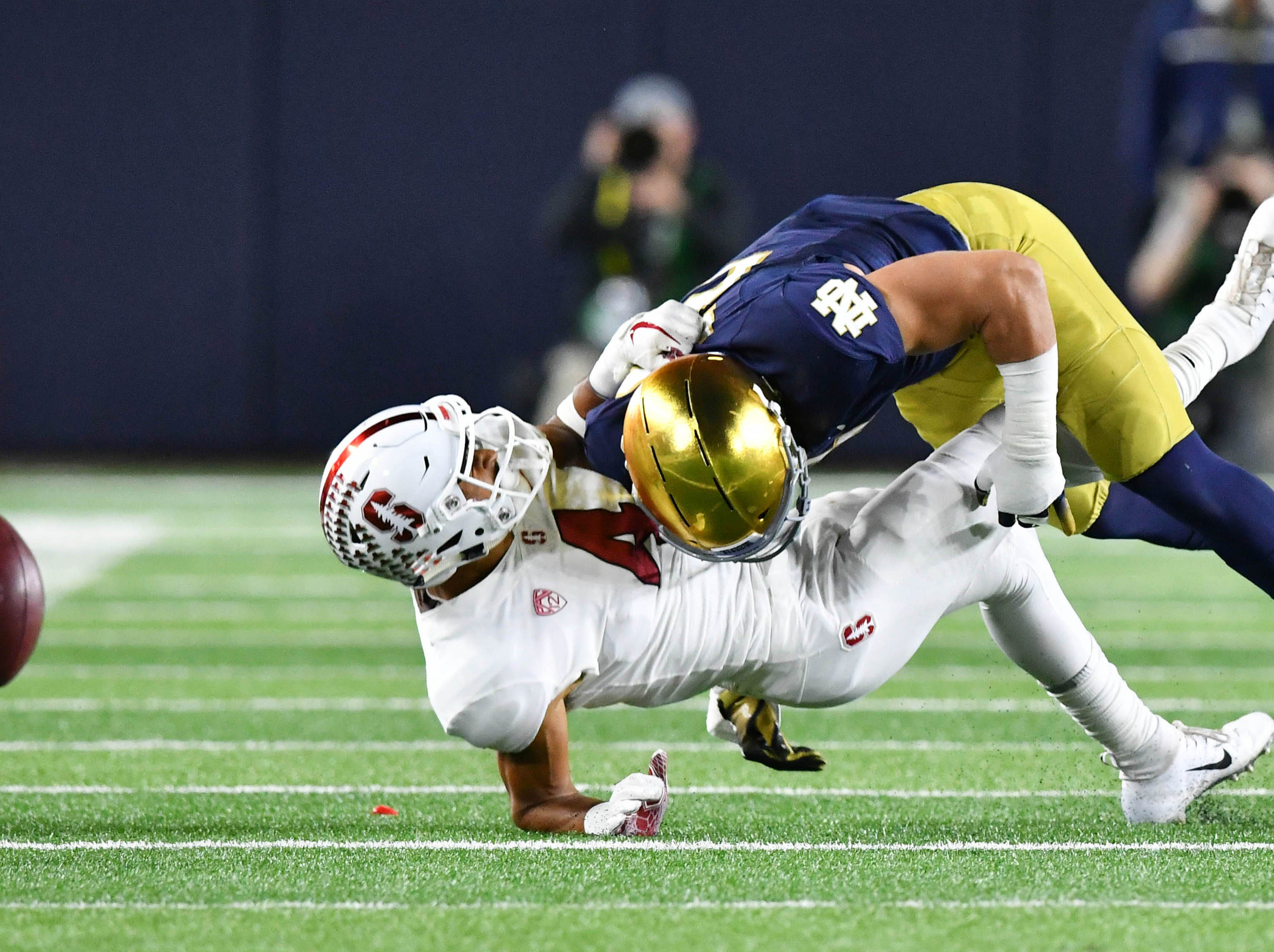 Notre Dame Fighting Irish linebacker Drue Tranquill (23) breaks up a pass intended for Stanford Cardinal wide receiver Michael Wilson (4) in the second quarter at Notre Dame Stadium.