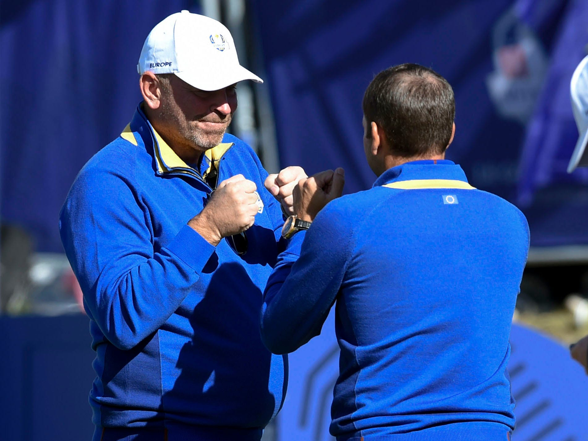 Europe captain Thomas Bjorn and golfer Sergio Garcia celebrate on the first tee during the Sunday singles matches.