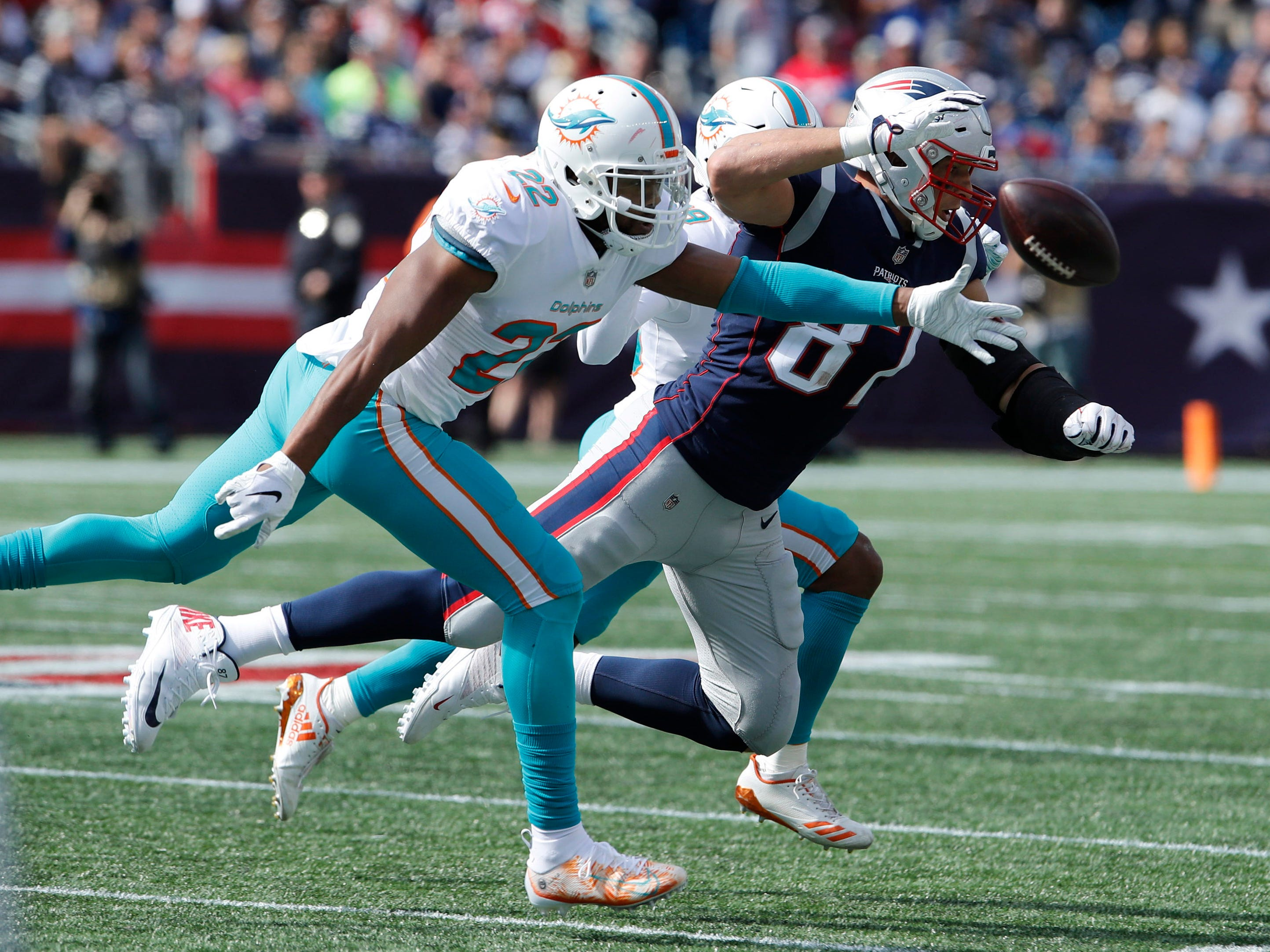 Patriots tight end Rob Gronkowski (87) under pressure from the Dolphins in the first half at Gillette Stadium.