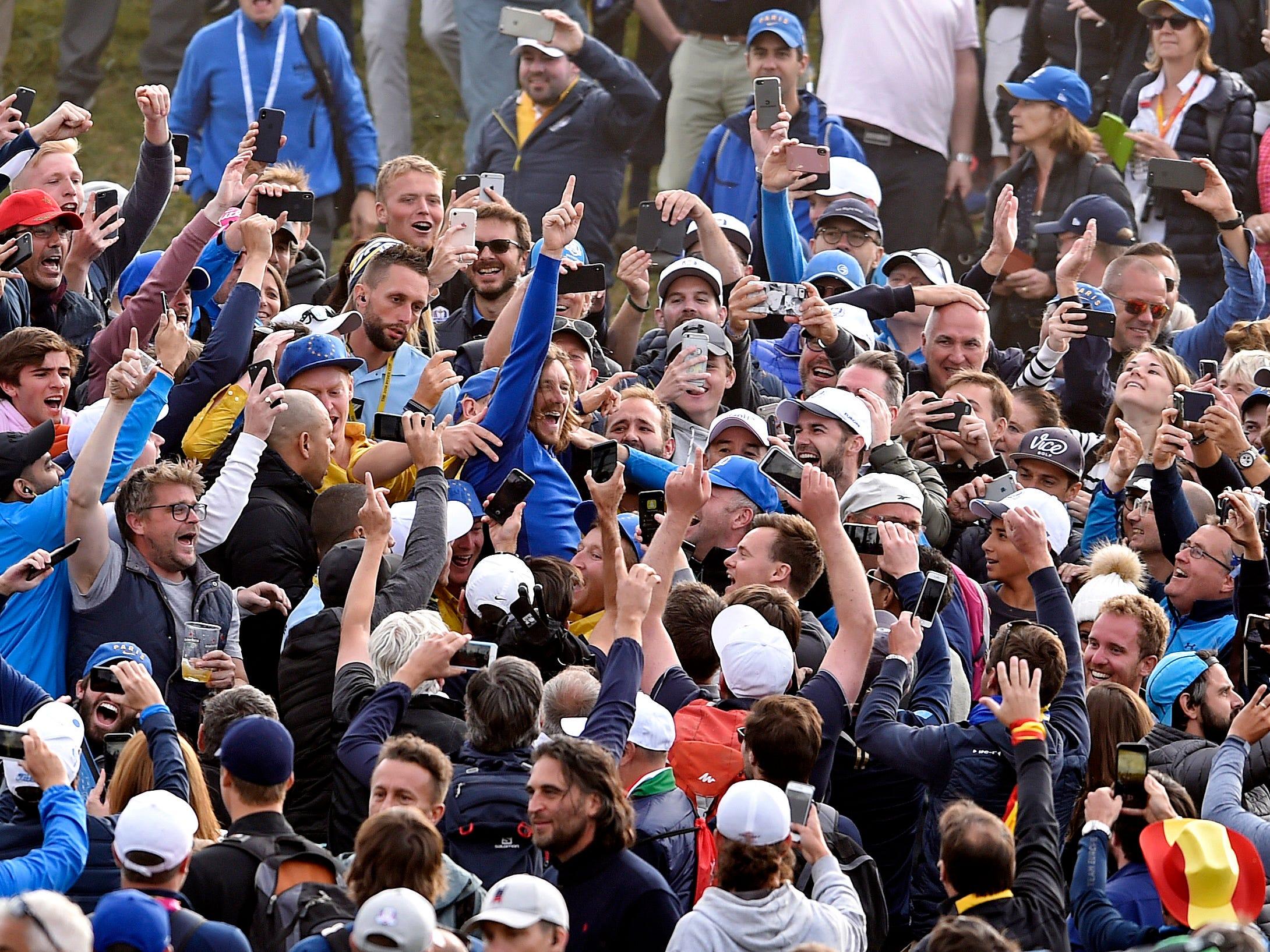 European fans engulf Tommy Fleetwood.