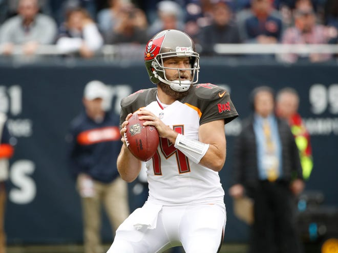 Tampa Bay Buccaneers quarterback Ryan Fitzpatrick (14) looks to pass the ball against the Chicago Bears during the first half at Soldier Field.