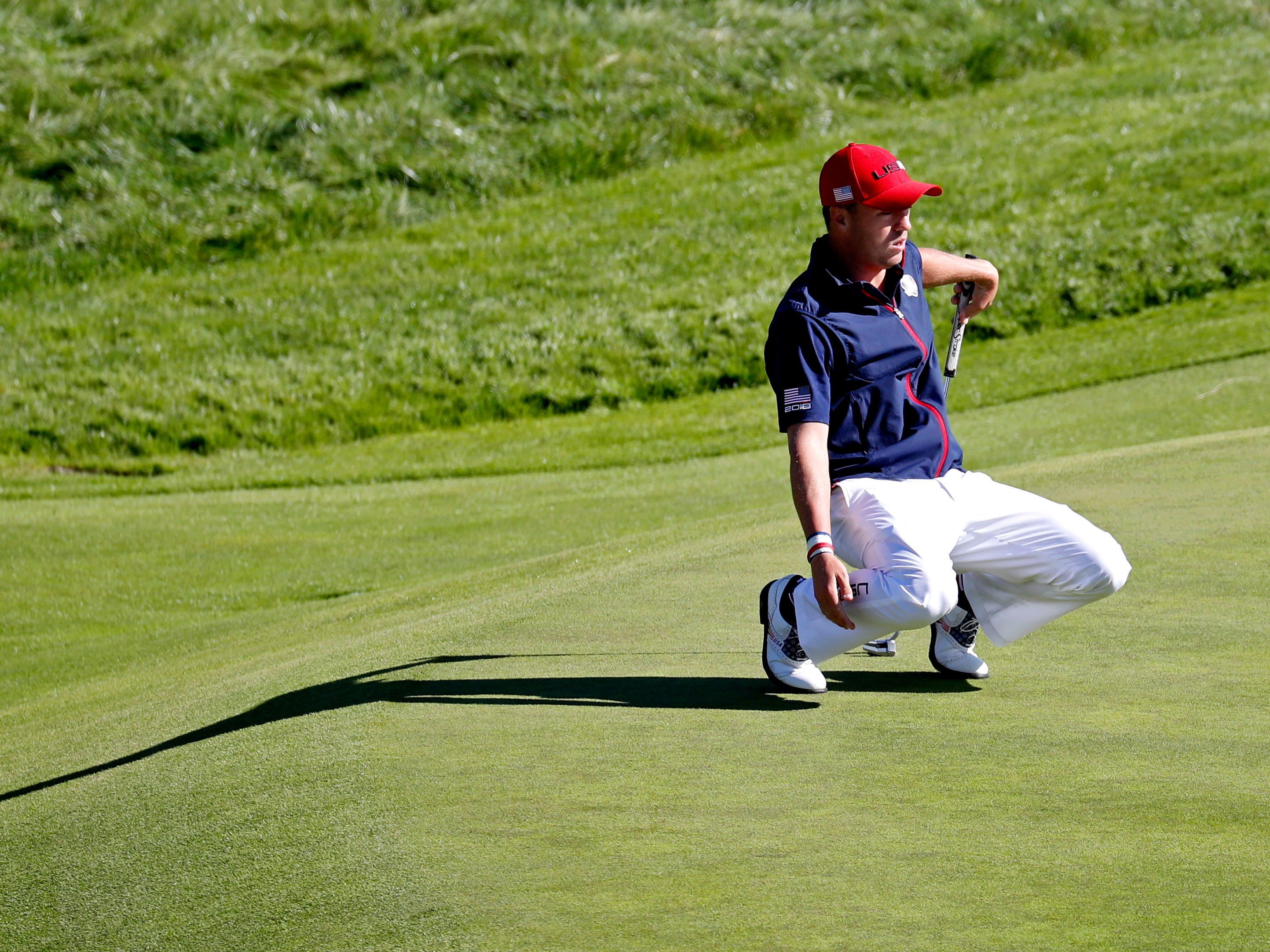 USA golfer Justin Thomas reacts to his putt on the ninth green during the Sunday singles matches.