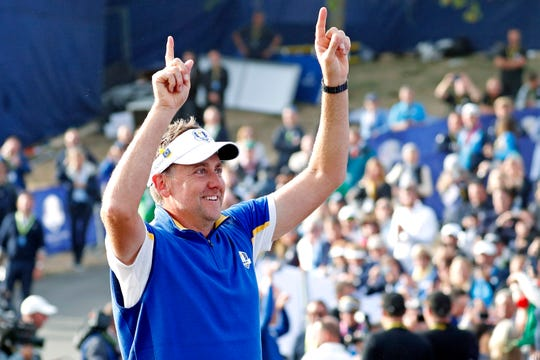 Ian Poulter celebrates after winning the Ryder Cup during Sunday singles matches at Le Golf National.