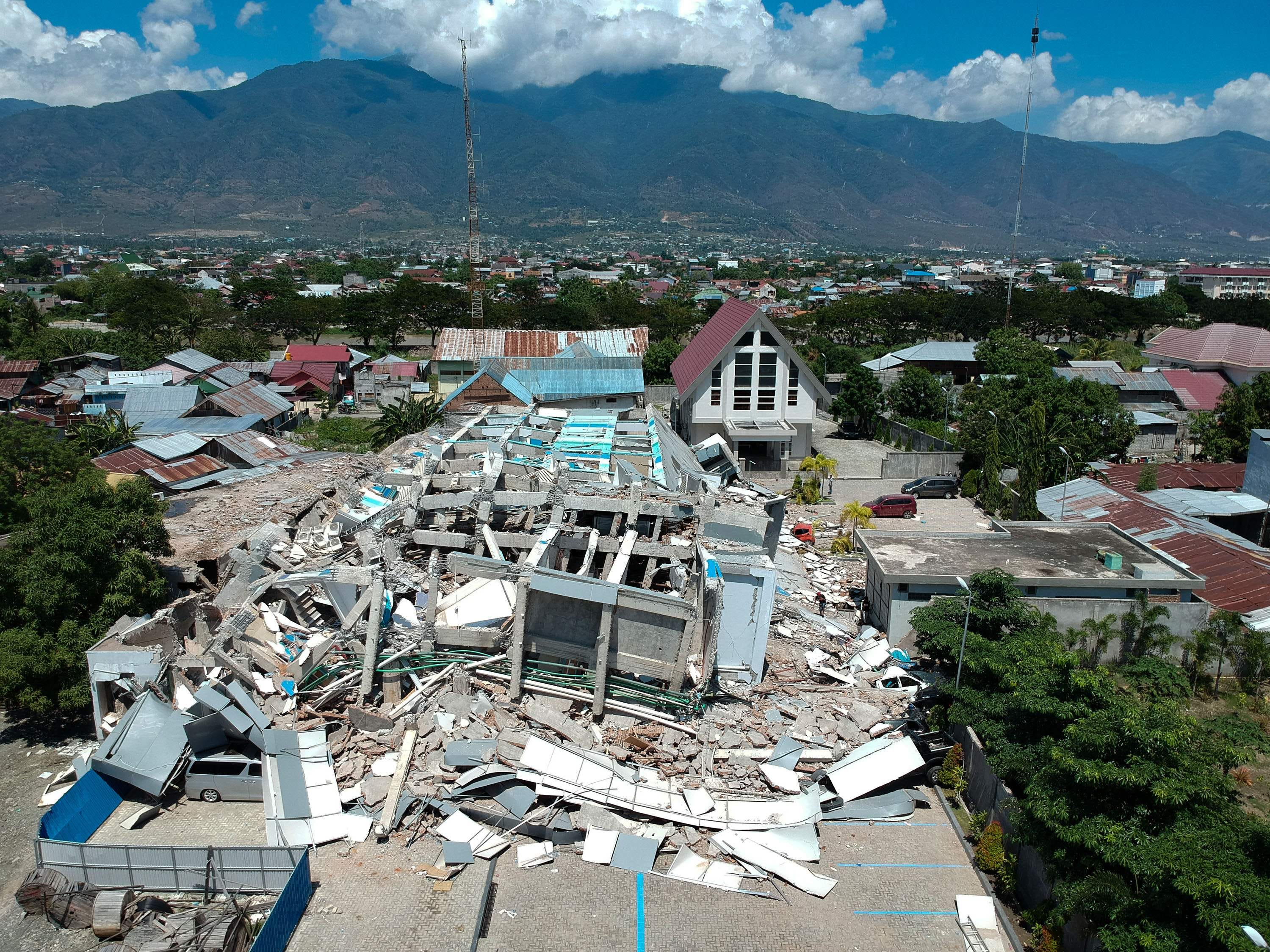 This aerial picture shows the remains of a ten-story hotel in Palu in Indonesia's Central Sulawesi on Sept. 30, 2018, after it collapsed following a strong earthquake.