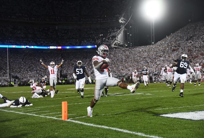 Ohio State Buckeyes wide receiver K.J. Hill (14) crosses the goal line to score the go-ahead touchdown in the fourth quarter against the Penn State Nittany Lions at Beaver Stadium.