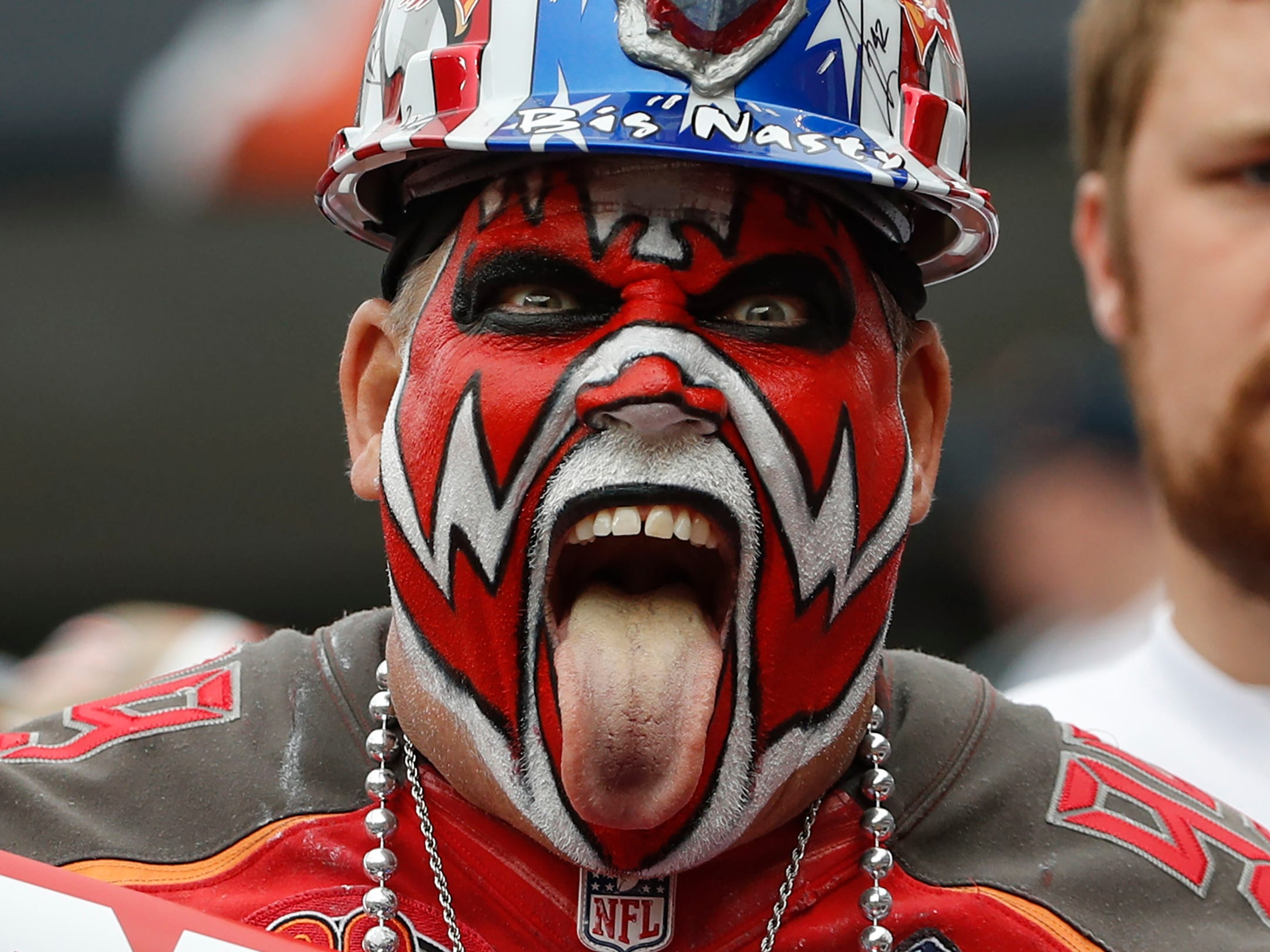 A Tampa Bay Buccaneers fan cheers on his team against the Chicago Bears at Soldier Field.