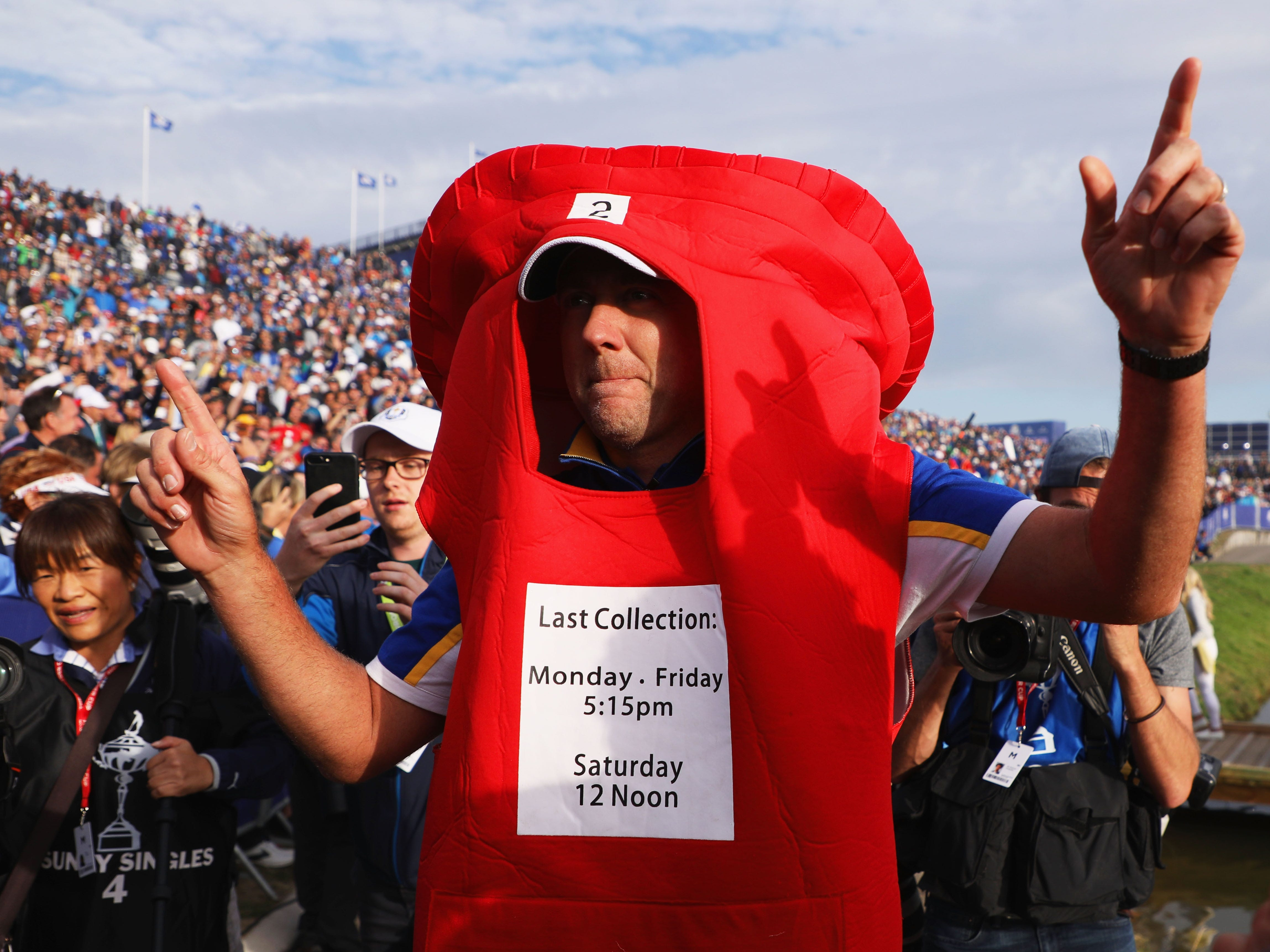 Ian Poulter celebrates by donning  a Post Box outfit after delivering again for Europe.