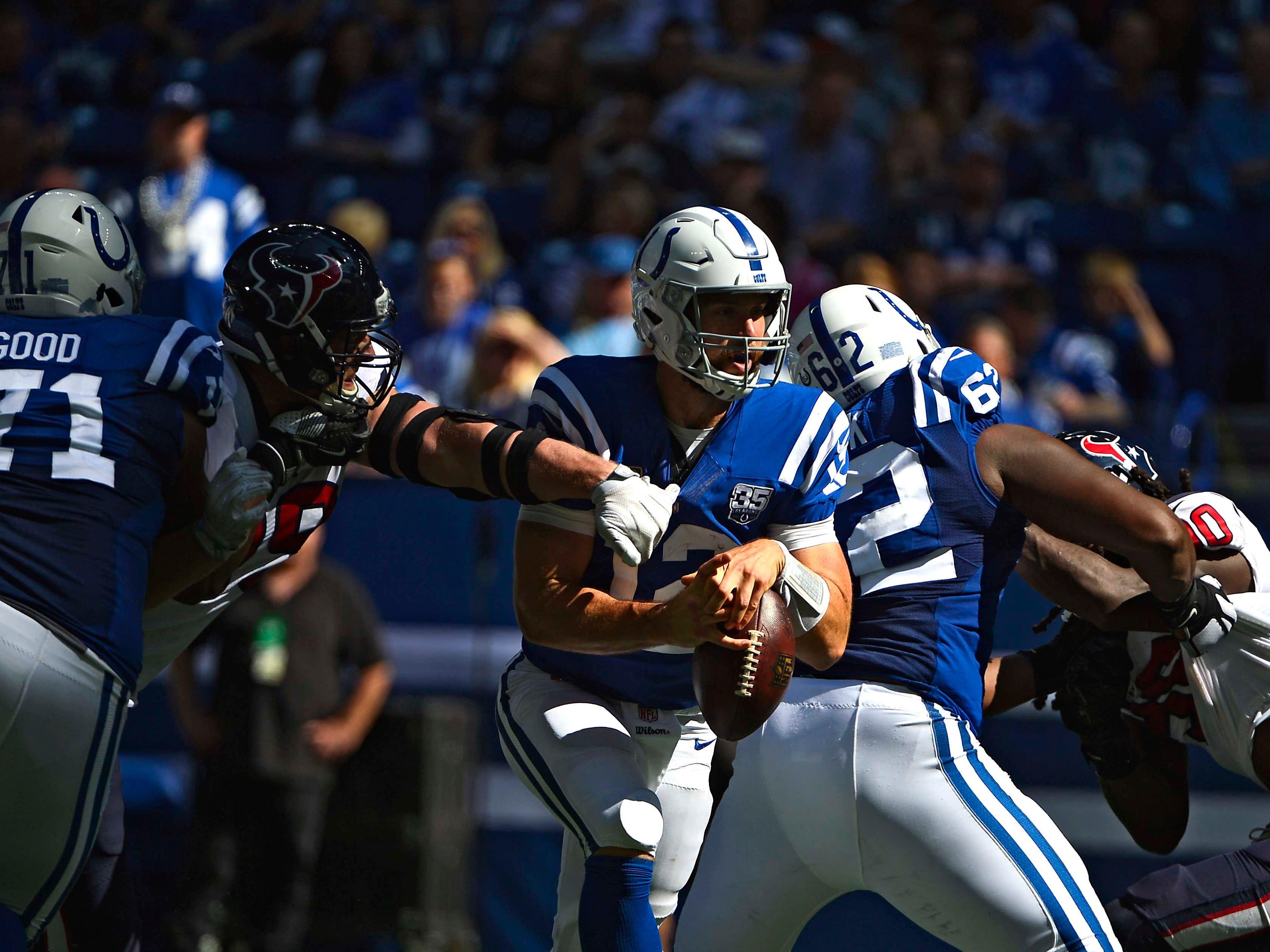 Texans defensive end J.J. Watt (99) forces a fumble by Colts quarterback Andrew Luck (12).