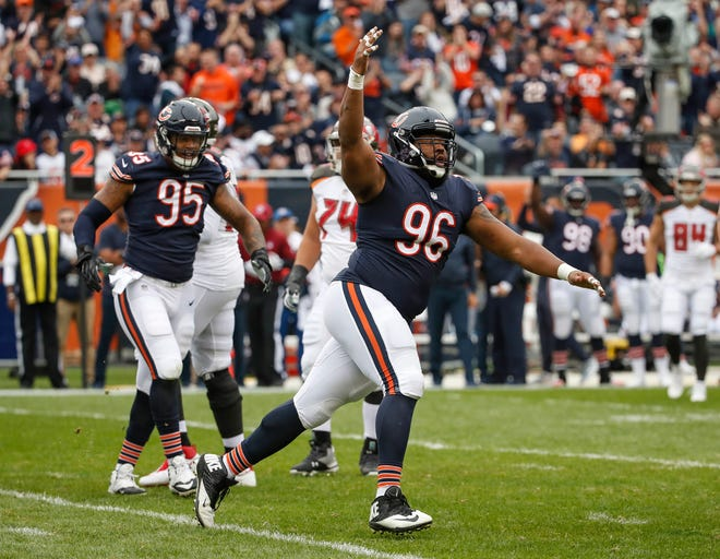 Chicago Bears defensive end Akiem Hicks (96) reacts after the defensive play against the Tampa Bay Buccaneers during the first half at Soldier Field.
