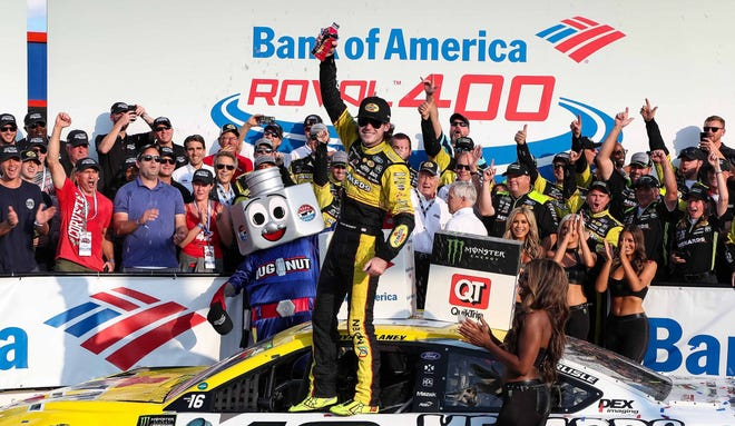 Ryan Blaney celebrates in victory lane after winning the inaugural Bank of America Roval 400 at Charlotte Motor Speedway.