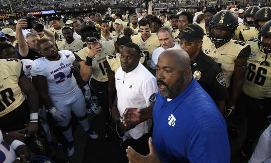 TSU head coach Rod Reed and Vanderbilt head coach Derek Mason explains the status of TSU linebacker Christion Abercrombie to their players after he was taken to the hospital during the game with a head injury at Vanderbilt Stadium Saturday, Sept. 29, 2018, in Nashville, Tenn.