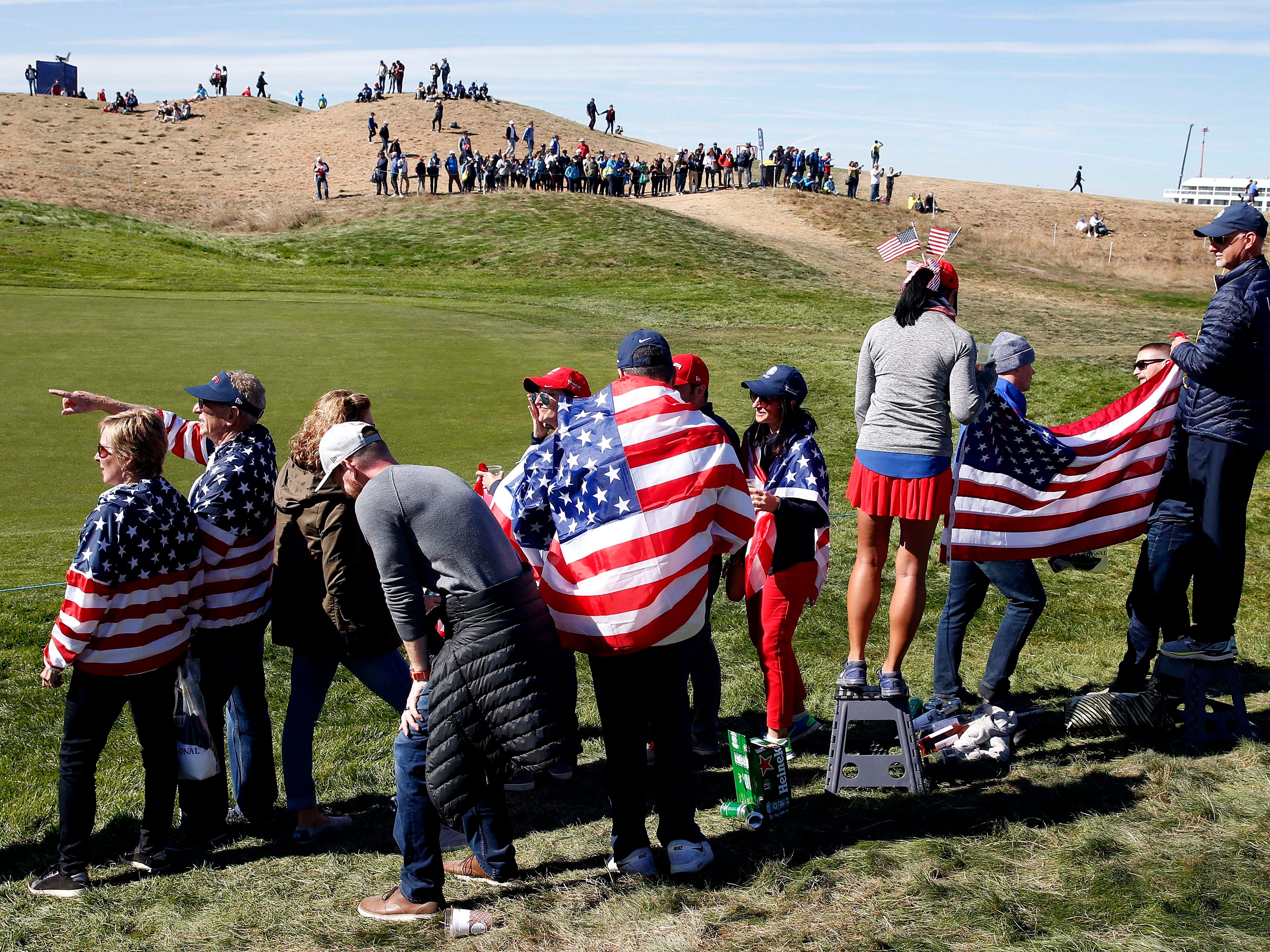 USA fans watch on the first hole during the Sunday singles matches.