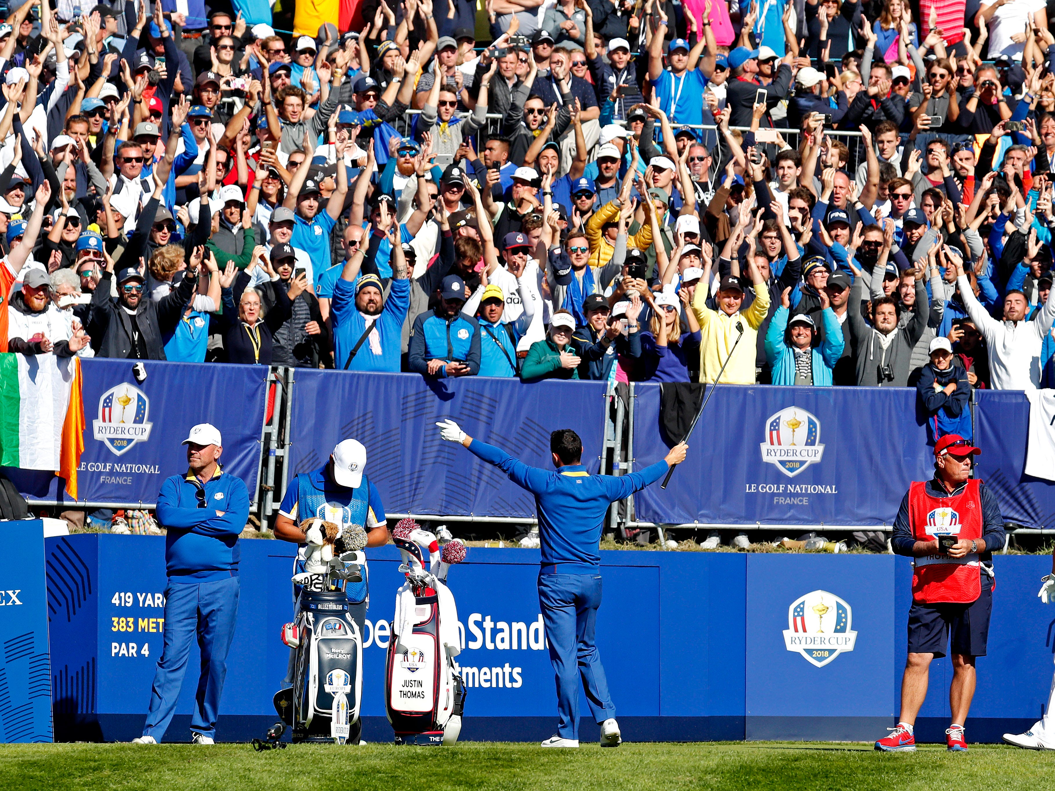 Europe golfer Rory McIlroy leads a cheer with fans during the Sunday singles matches at Le Golf National.
