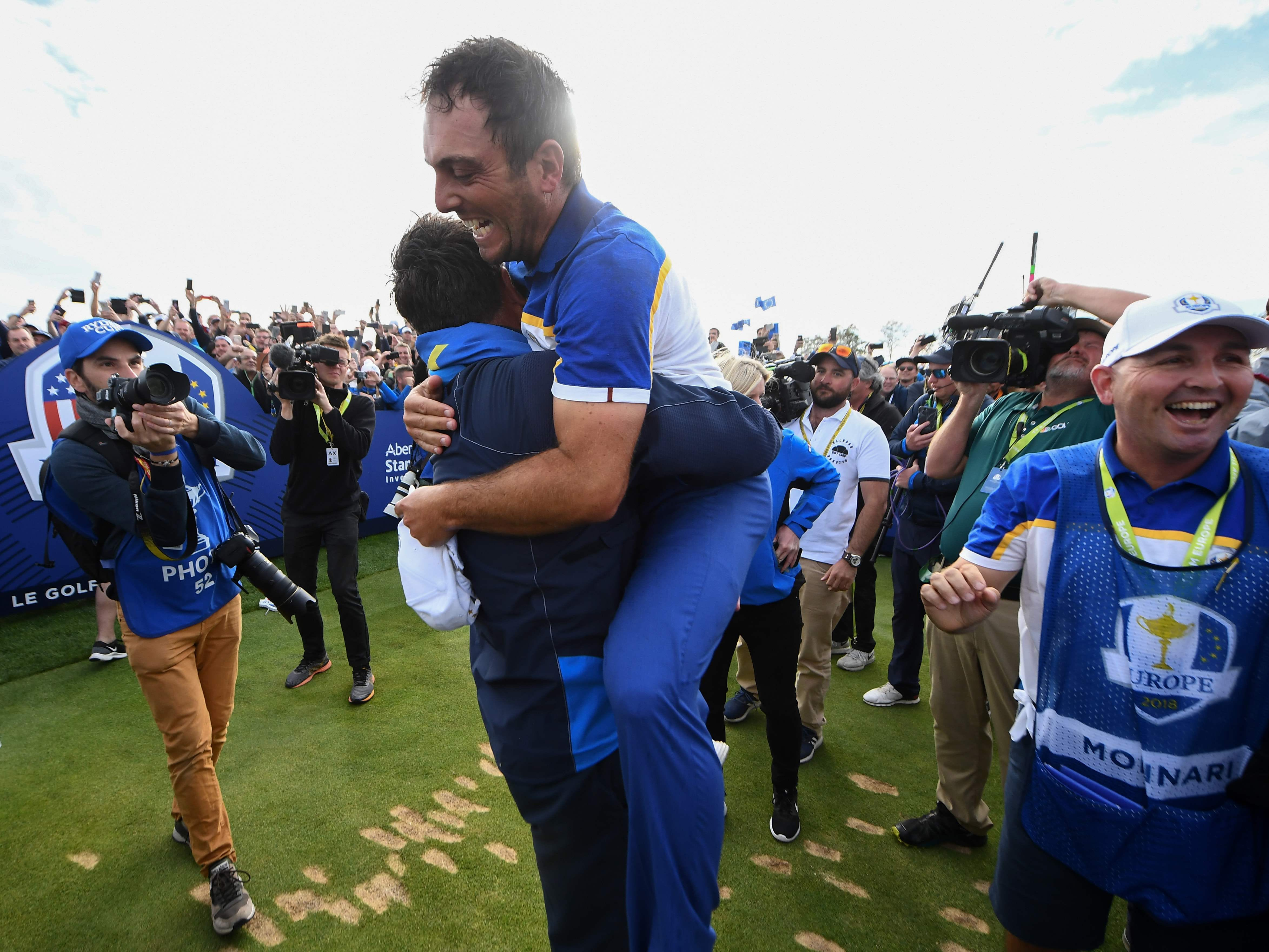 Francesco Molinari celebrates victory after his singles victory clinched the Ryder Cup for Europe.