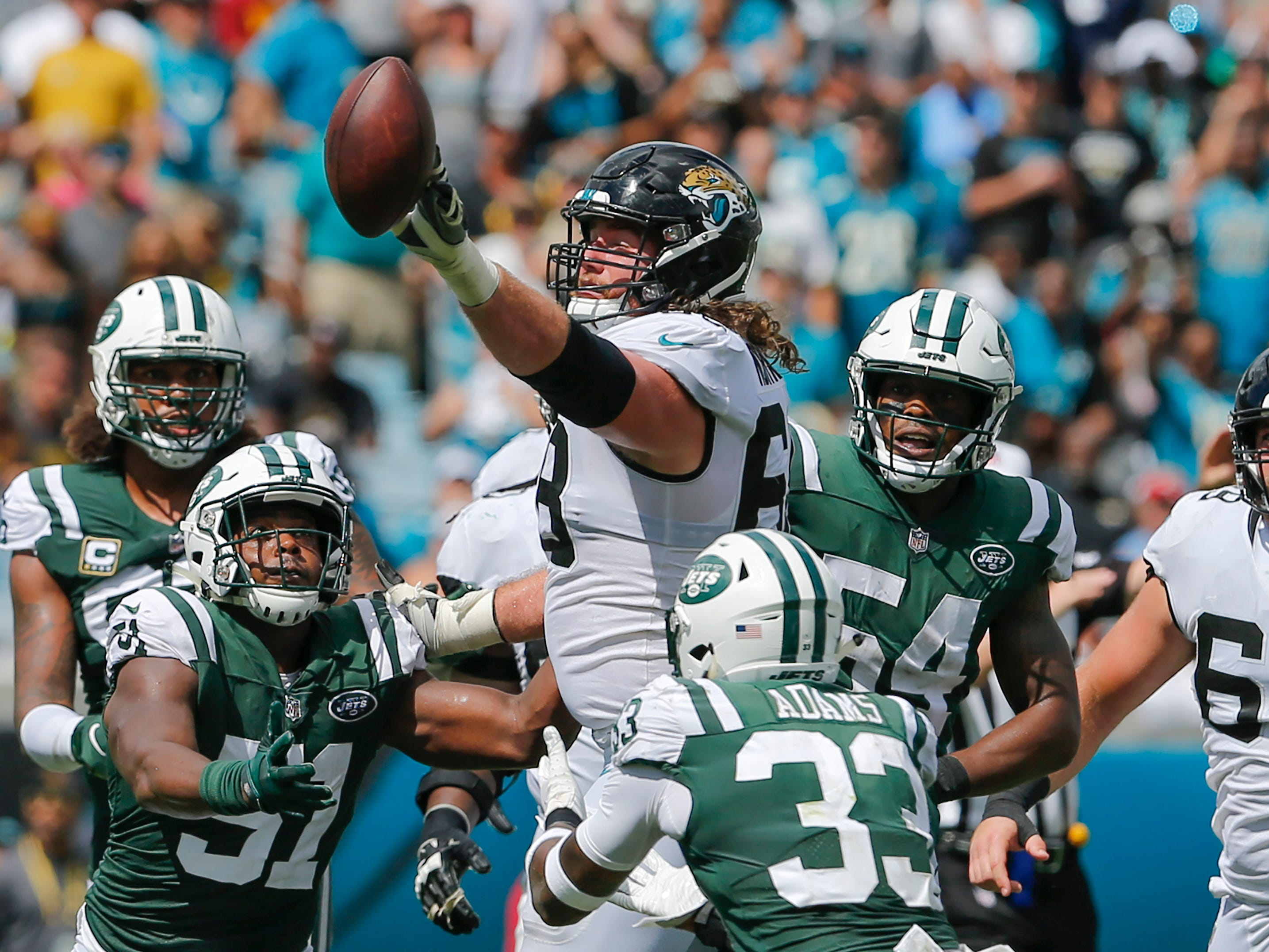 Jacksonville Jaguars offensive guard Andrew Norwell (68) bats down a tipped pass to prevent an interception during the second quarter against the New York Jets at TIAA Bank Field.