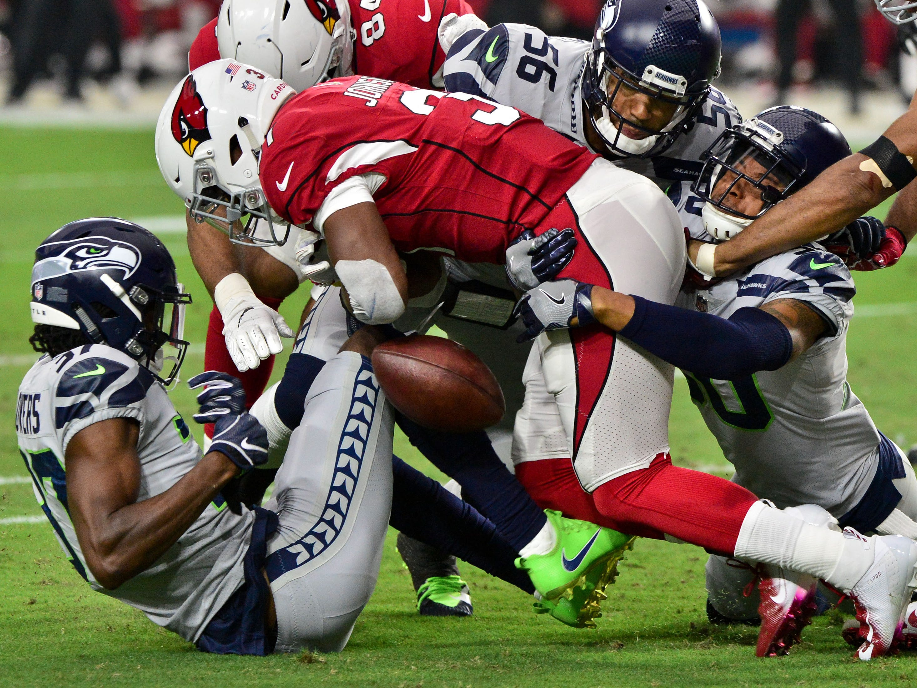 Arizona Cardinals running back David Johnsonfumbles the ball while being tackled in the first half against the Seattle Seahawks.