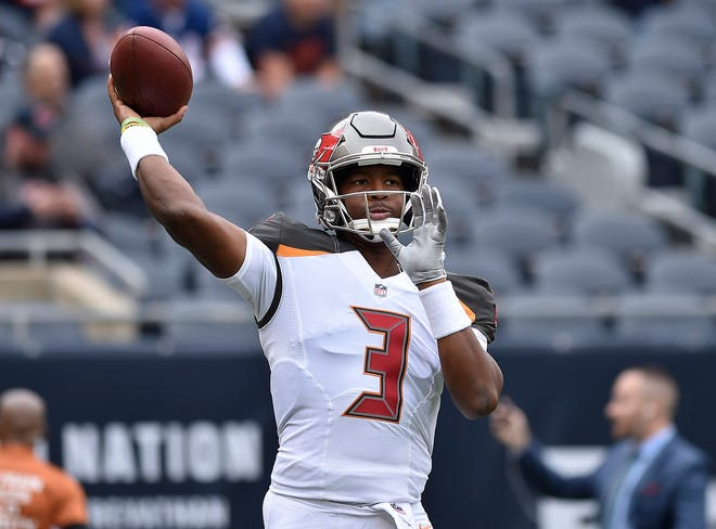 Tampa Bay Buccaneers quarterback Jameis Winston (3) warms up before the game against the Chicago Bears at Soldier Field.
