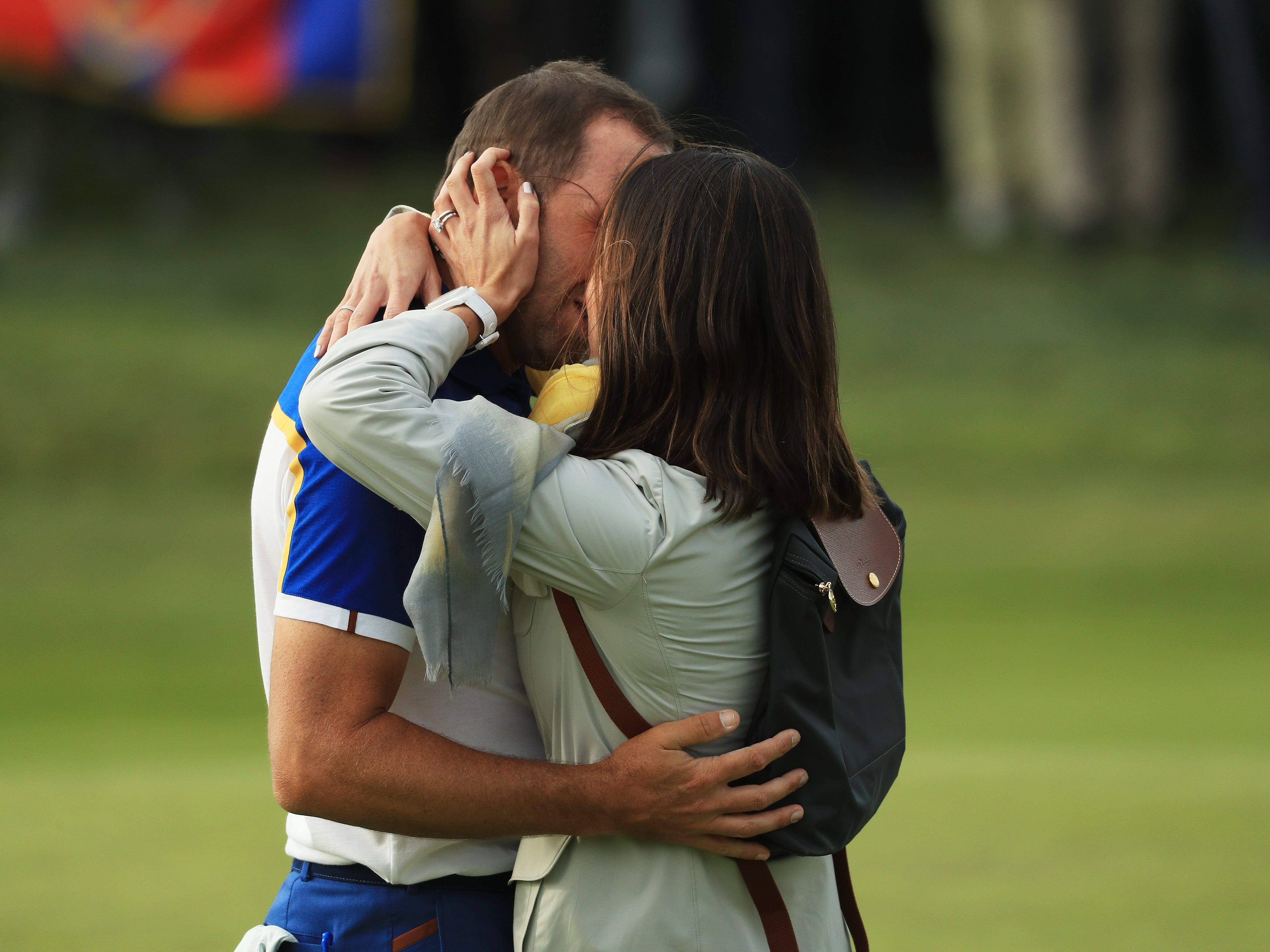 Sergio Garcia and wife Angela Garcia share a kiss.