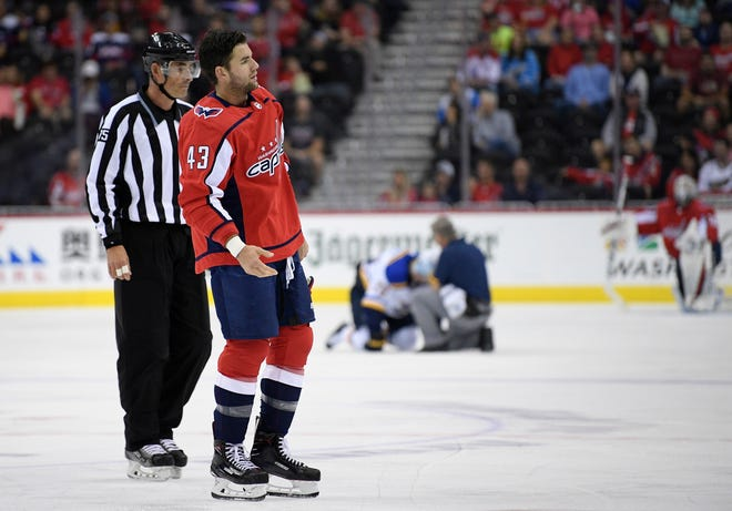 Washington Capitals right wing Tom Wilson is escorted off the ice after he checked St. Louis Blues center Oskar Sundqvist during the second period.