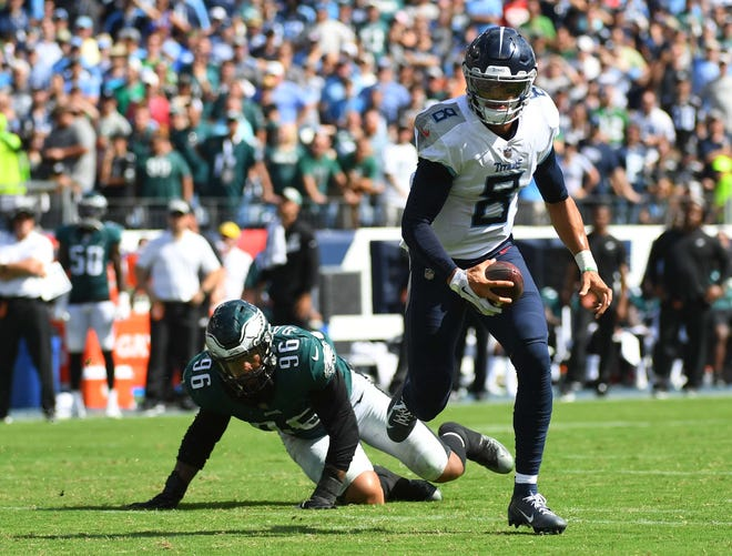 Tennessee Titans quarterback Marcus Mariota (8) scrambles out of the pocket for a touchdown run during the second half against the Philadelphia Eagles at Nissan Stadium.