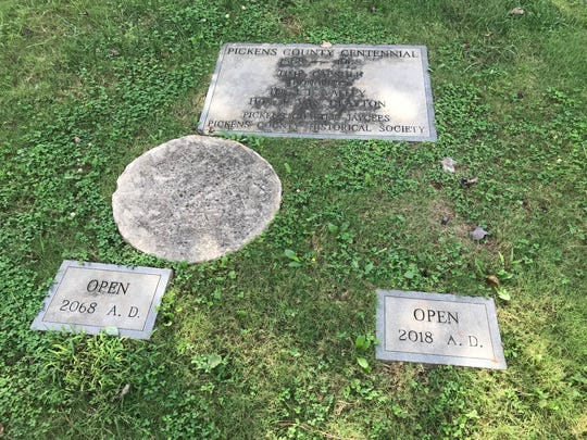 Time capsules buried outside the Pickens County courthouse for its centennial in 1968. One is to be opened Friday.