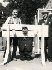 R.C. Edwards, then president of Clemson University, is pictured in stocks, wearing a rat hat, as part of Pickens County's celebration of its centennial in 1968.
