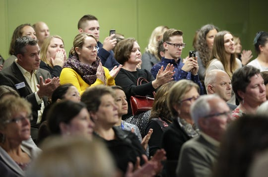 A crowd listens Monday during the announcement of the merger of three nonprofit organizations that serve the homeless in the Fox Cities.