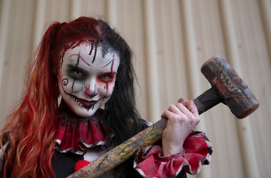 Gianna Stanton of Westhampton, NJ, is armed and ready as she plays a possessed clown at Six Flags Great Adventure Fright Fest.