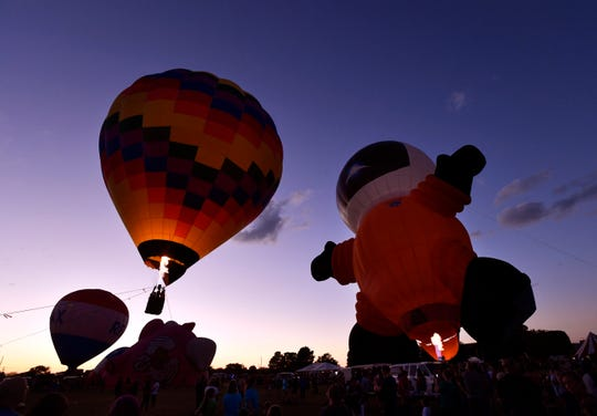 The Cosmos I hot air balloon, shaped like a giant astronaut, rises in the evening sky during the balloon glow Saturday at the Big Country Balloon Fest in Redbud Park Sept. 29, 2018.