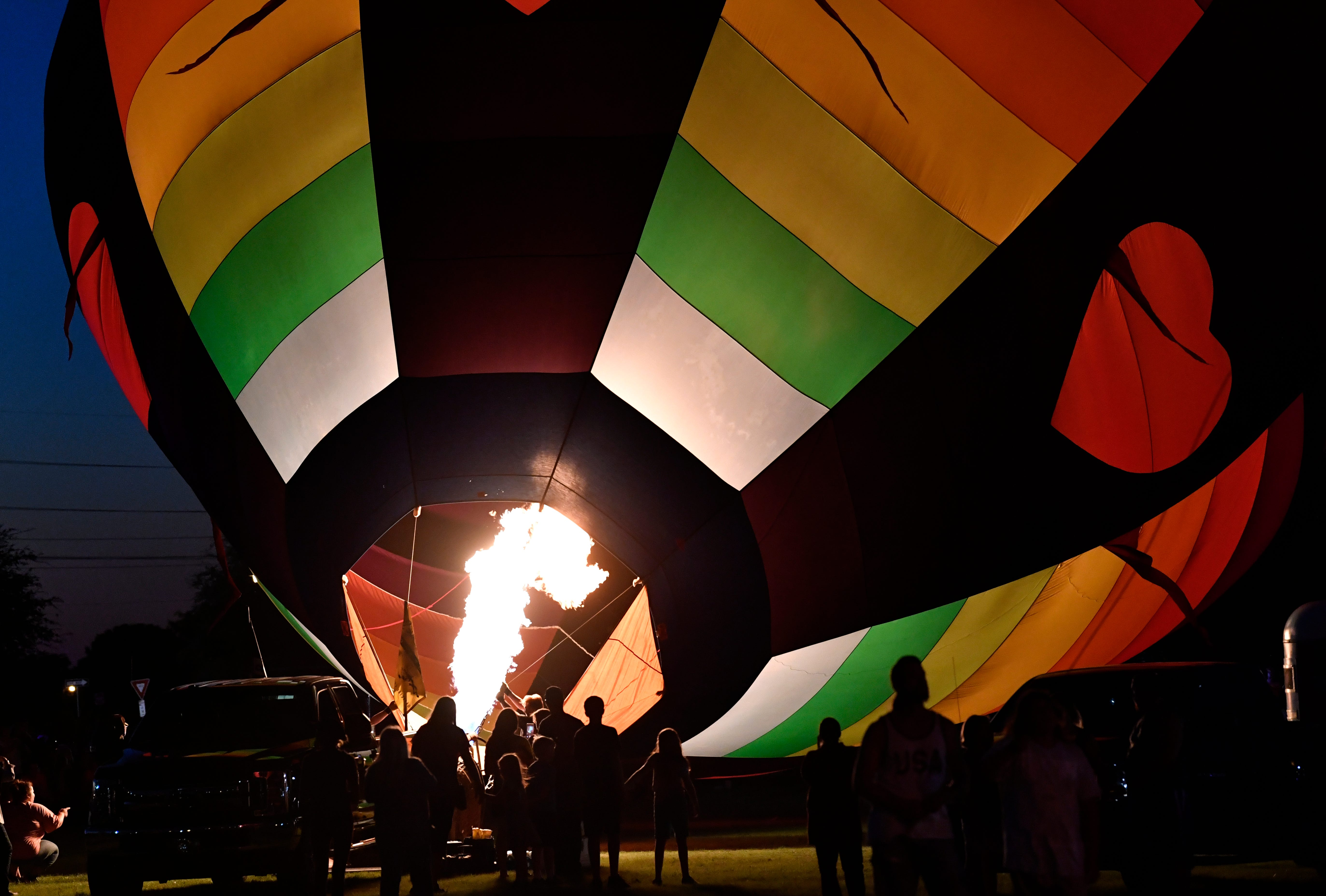 Spectators watch as a crew inflates the Shotgun Rider hot air balloon. Saturday evening saw a successful balloon glow at the Big Country Balloon Fest in Redbud Park.