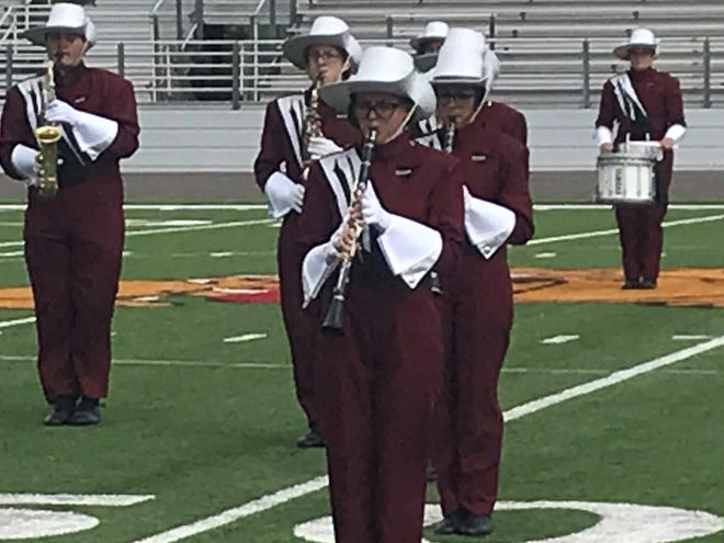 Jade Shipp, center, a clarinet player in the Hawley High School marching band, performs with her squad during the Big Country Marching Festival at Wylie High School's Bulldog Stadium on Monday. The annual event gives bands an idea of what to work on before the UIL marching contest. Most area schools will be participating in the East Zone contest Oct. 22 at Wylie.
