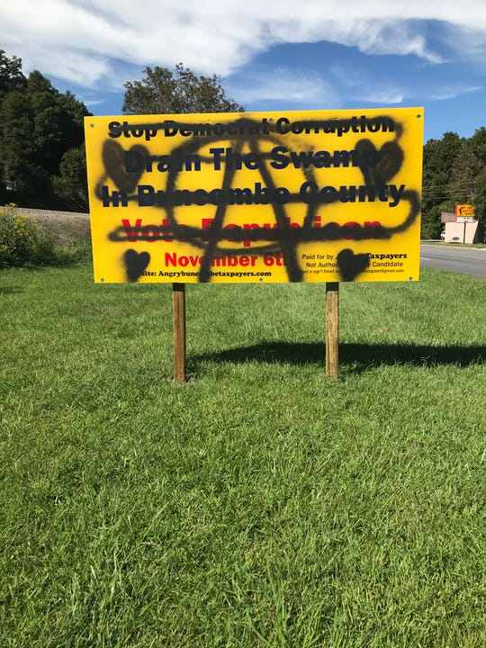 More than a half dozen signs put up by Angry Buncombe Taxpayers have been vandalized or damaged, including this one in Swannanoa.