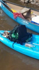 Asheville GreenWorks volunteer Charlie Chang said this backpack exploded in his kayak about a minute after he picked it up from the French Broad River on Saturday. Police said it held a mobile methamphetamine lab.