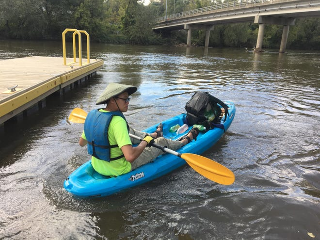 Charlie Chang found the black backpack in the French Broad River during a Saturday cleanup. It contained bottles used for making methamphetamine and exploded just moments after he snagged it from the water.