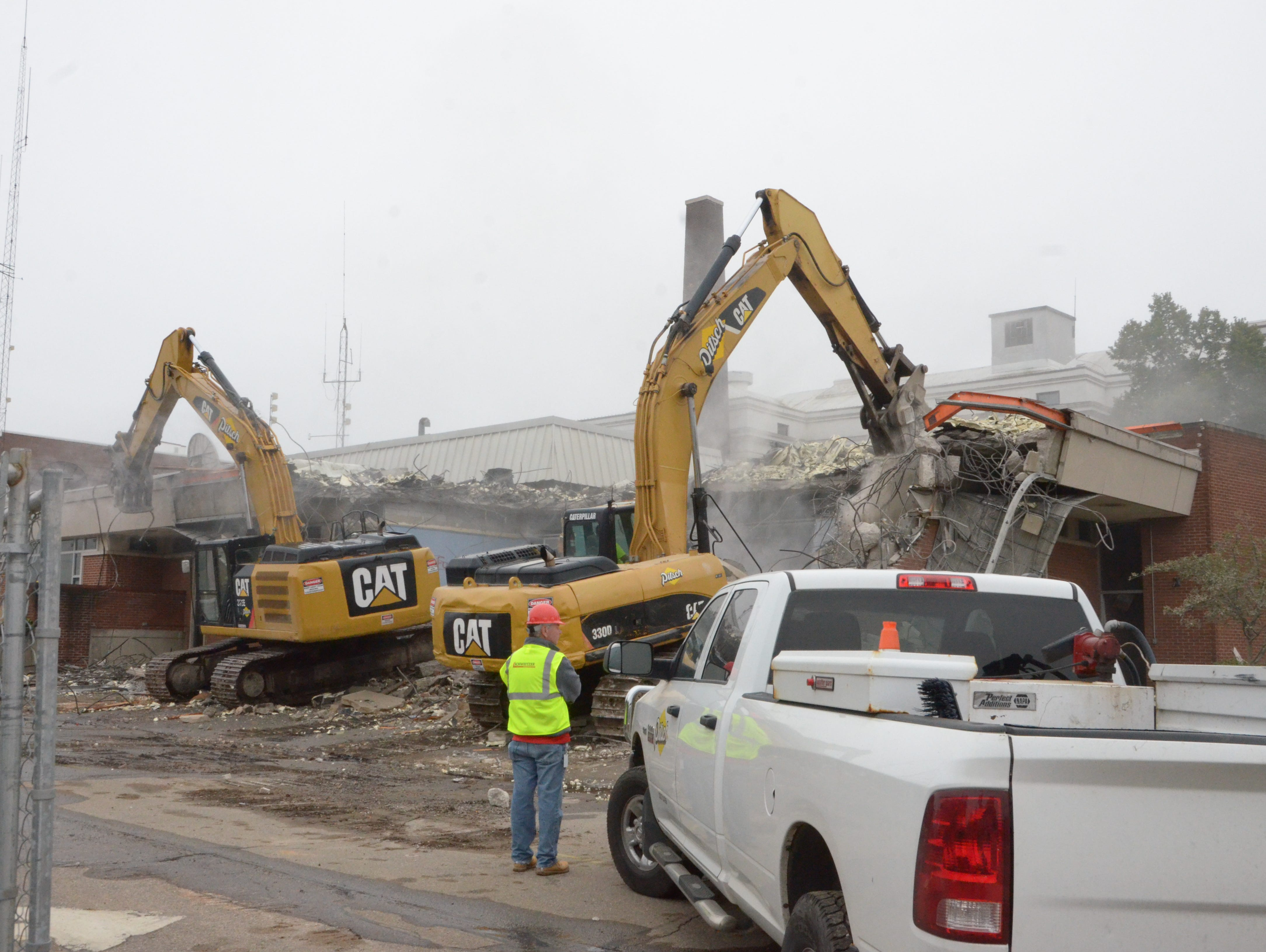 Chris Curry, Schweitzer Construction project superintendent, oversees the demolition of the old Battle Creek Police Department headquarters.