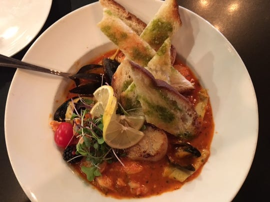 New to downtown Battle Creek, Kitchen Proper features gourmet food with beautiful plating such as this Fisherman's Stew.