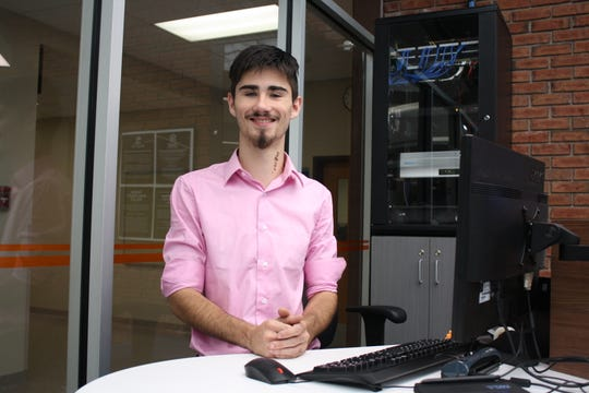 Alex James Ford, 17, of Port Crane, is a student worker at the new Visions Federal Credit Union branch office at Broome-Tioga BOCES main campus in Binghamton.