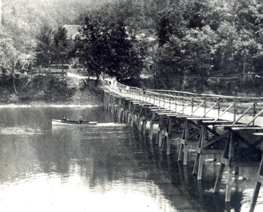 The original wooden bridge across the Chemung River.