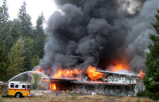The building on Arsenal Way in Bremerton, which once house Perl's Pavilion and later Natacha's, burned on Monday.