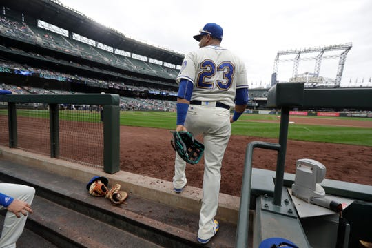 Nelson Cruz prepares to take the field before Sunday's season finale. Was it his last game with the Seattle Mariners?