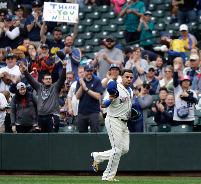 Nelson Cruz salutes the crowd after he was removed from Sunday's season finale during the fourth inning. Cruz's contract expires this offseason, and the question of whether he will return to Seattle looms large for the team's future.